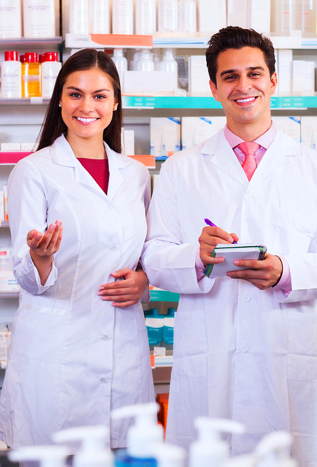 male and female pharmacists smiling